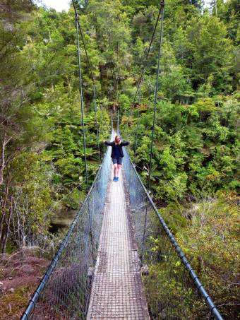 Steph stands on the famous Abel Tasman swing bridge as we walk part of the track