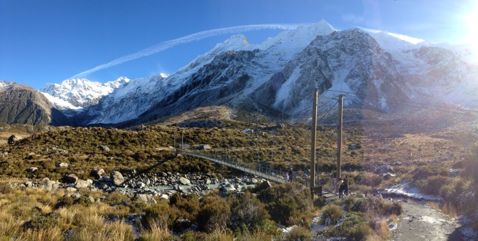 A bridge over the Hooker River, with Mount Sefton in the background