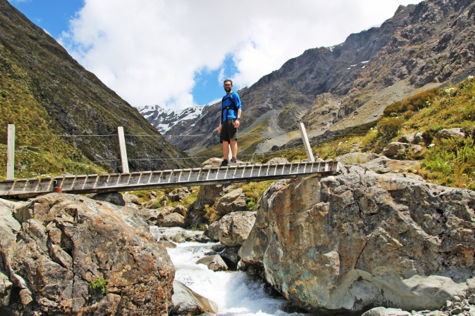 Steve crossing a bridge over a stream in Arthur's Pass