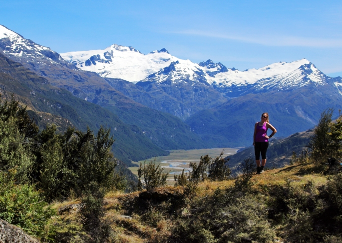 Steph stands on the Invincible Gold Mine Track with the Rees Valley behind her